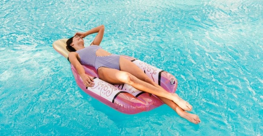 posh pool article woman in swimming pool